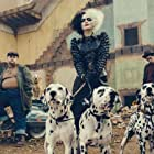 Emma Stone, Joel Fry, and Paul Walter Hauser in Cruella (2021)
