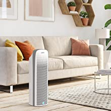 PureZone Elite 4-in-1 Air Purifier purifying the air in a living room.