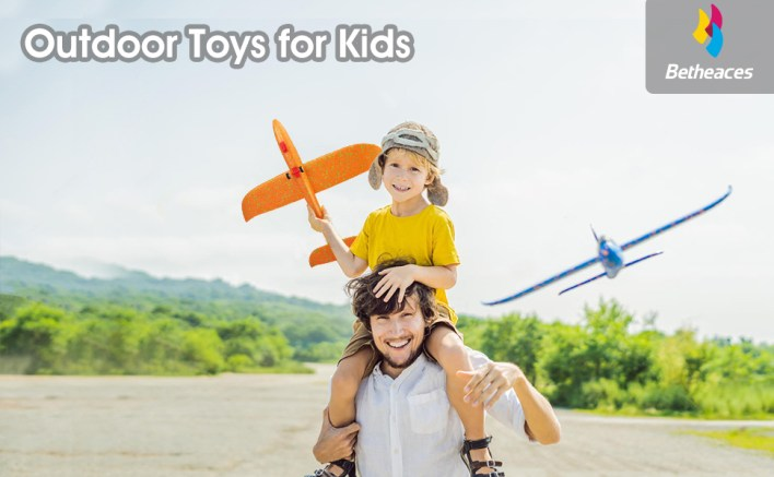 Dad and son are playing the airplane toy