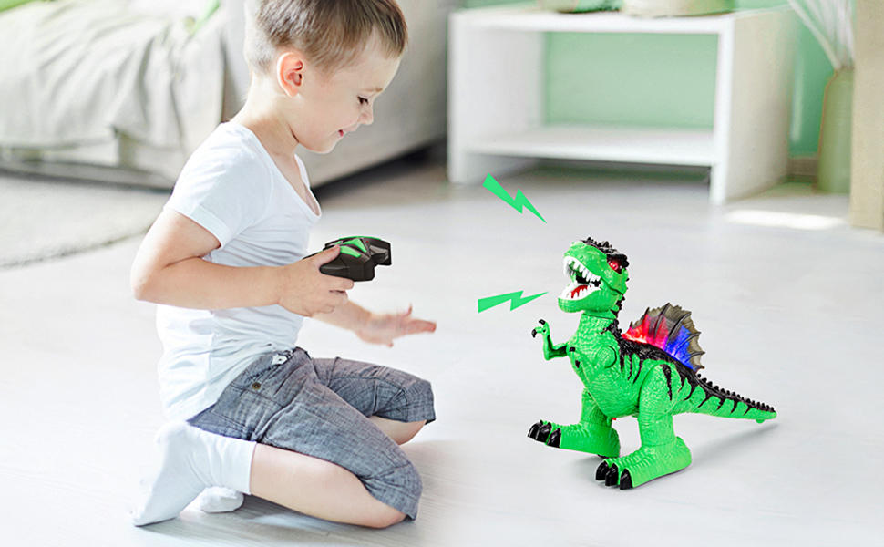 Kid playing with remote control dinosaur