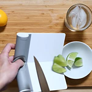 chopped limes being funneled into small bowl using scooper