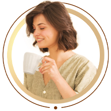 Woman enjoying fresh coffee made from portable french press