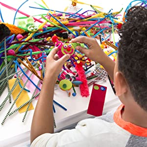 boy playing with arts and crafts kit