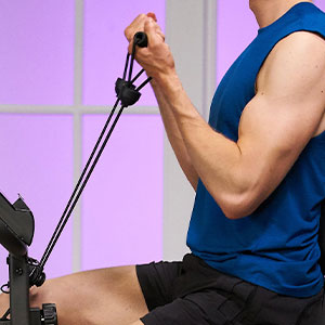 Man using attached resistance bands to sculpt muscles and upper body