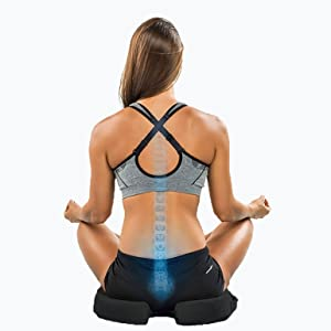 Ergonomic seat cushion with cut out to relief pressure from spine while sitting, floating coccyx