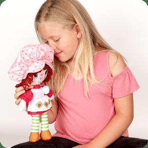 Imagem de estilo de vida de menina cheirando boneca