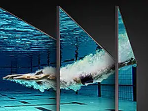 "Samsung 65"" Q90R QLED Flat Smart 4K TV - QLED TV with underwater scene of a swimmer diving into a pool from multiple angles"