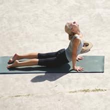 Calm, energetic lady doing Yoga on Bondi Beach