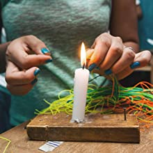 girl making jewelry with candle