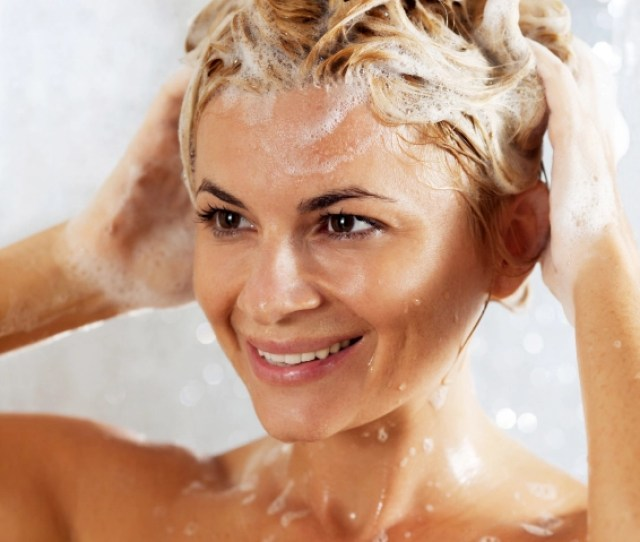 Pretty Beautiful Woman Washing Her Hair In A Shower Close Up