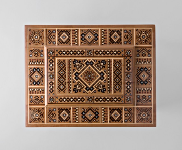 Big wooden box inlaid with beads and other wood pieces.