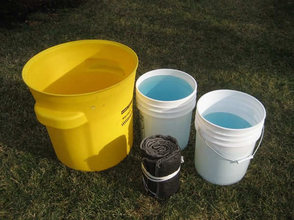 Buckets filled with solution and Suber absorbent sock before soaking