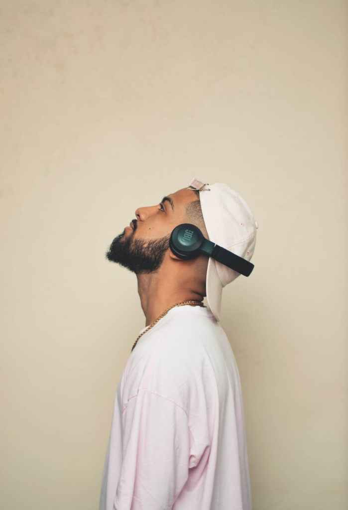 photo of man listening with jbl wireless headset