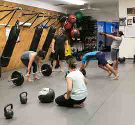 Group M3 Fit physical conditioning class kettle bell and olympic bar lifting