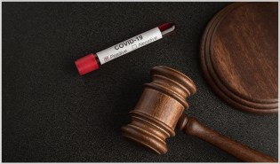 COVID-19 Liability Immunity law - Vial marked positive next to gavel