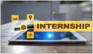 Internship word with icons around ipad on wooden desk