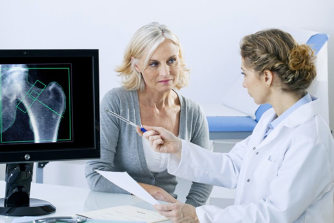 Osteoporosis consultation with an older woman 2019
