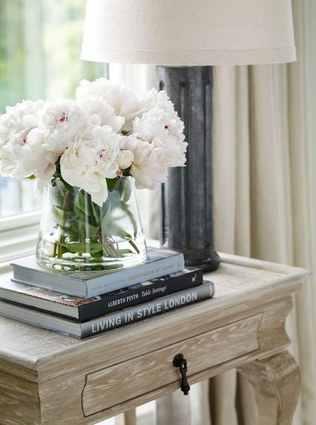 Dream House White Flowers in Vase Books and Candles on End Table