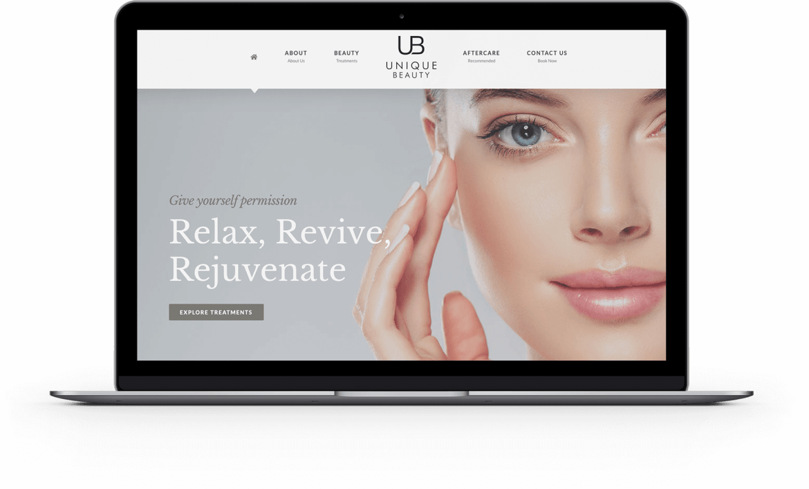 laptop with Unique Beauty website image