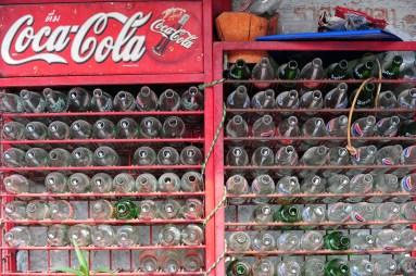 Row of empty Coke bottles