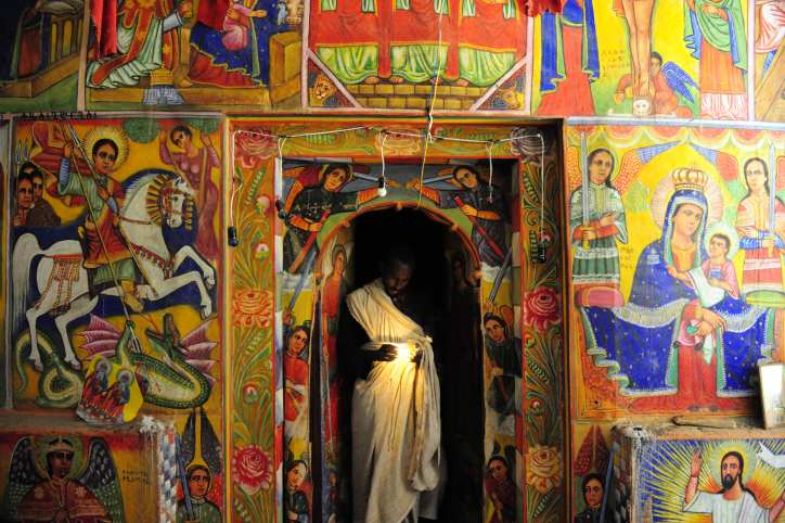 Inside the church, the murals were beautiful. Only the priests could go past the door.