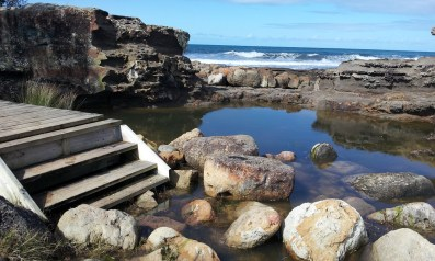 Steps leading up from a rock pool.