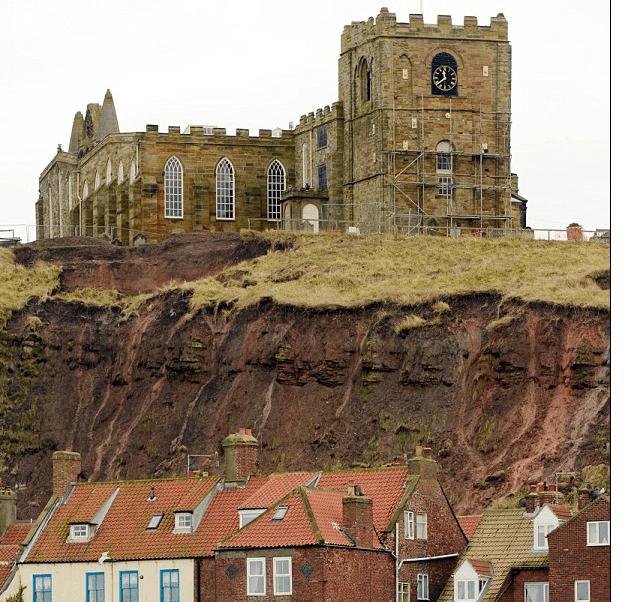 http://www.dailymail.co.uk/news/article-2259560/Dracula-church-raining-bones-Debris-cliff-graves-falls-town-landslide.html