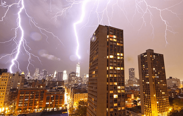http://www.dailymail.co.uk/news/article-2335601/Dramatic-moment-lightning-bolt-strikes-One-World-Trade-Centre-lights-New-York-skyline-thunderstorm-batters-city.html