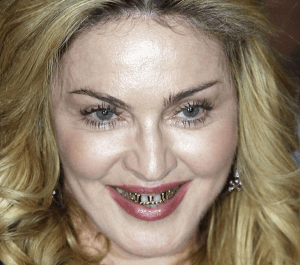 http://www.dailymail.co.uk/tvshowbiz/article-2399456/Madonna-55-shows-gold-grills-pays-visit-Hard-Candy-fitness-studio-Rome.html