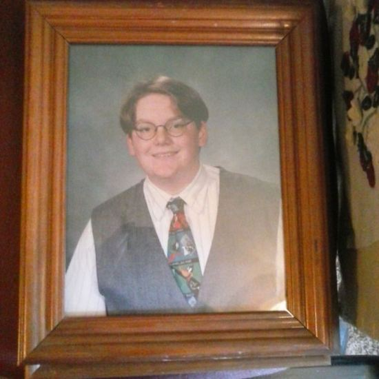 Framed picture of Matt in 8th grade wearing a stylish tie and vest.