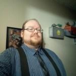 Matt in a striped shirt and tie