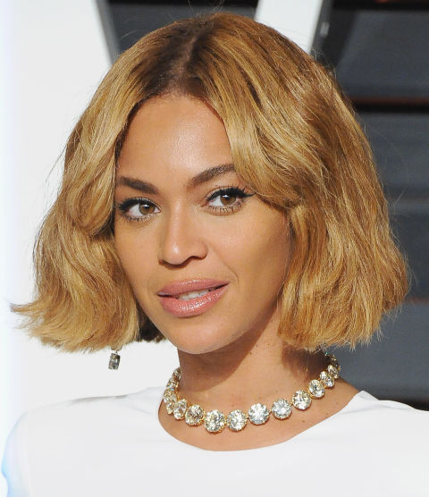 One of our favorite Bey looks yet. The blunt ends and golden highlights give this bob a cool-girl flair.