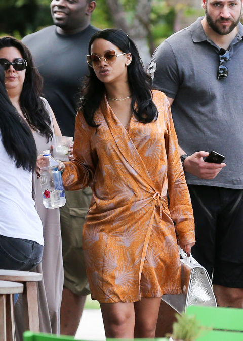 After performing in Jacksonville over the weekend, RiRi hit Miami for a pool party. She sipped on Red Stripes while donning a print silk kimono and oversized shades.