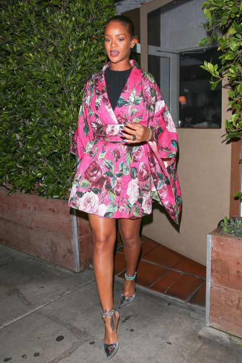 While dining at her favorite Italian restaurant Giorgio Baldi in California, RiRi donned a hot pink, floral-printed kimono with strappy heels. Thanks to the mini hemline, she was able to show off her famous stems.