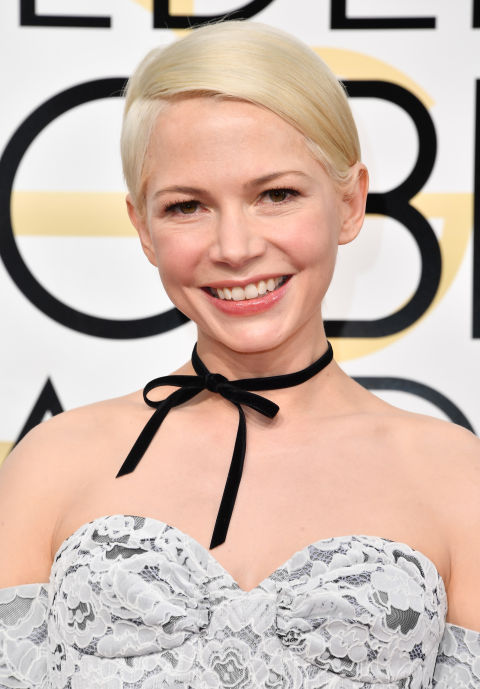 Platinum-blonde Michelle Williams might be our favorite versionof Michelle Williams, like ever;hereher signature crop is flat-ironed like asatin sheet and tucked behind both ears. Sweet and chic.