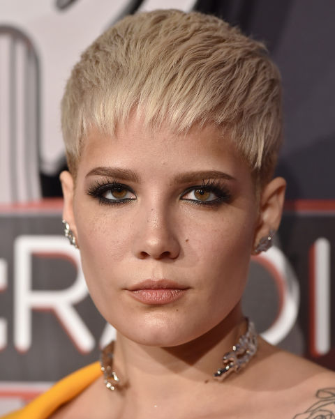 Not your average pixie cut alert: if you're got a boyish shape like Halsey's,brush your bangs toward your eye-line if they're super-shorn instead of angling them back.
