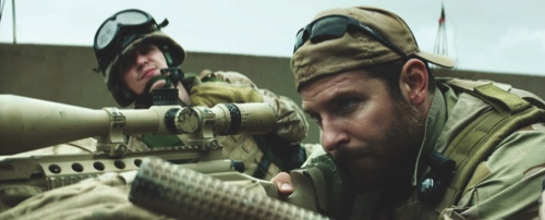 """Kyle Gallner, left, and Bradley Cooper appear in a scene from """"American Sniper"""""""