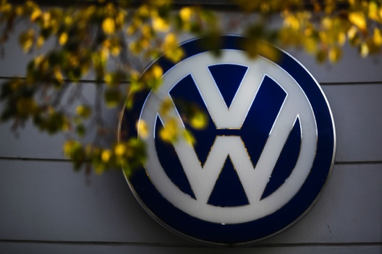 The VW sign is displayed in Berlin, Germany