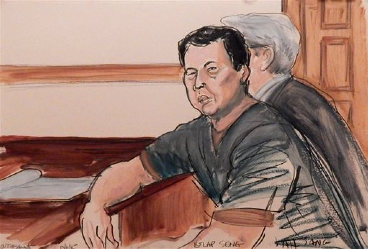 In this courtroom sketch, defendant Ng Lap Seng is seated in court at the defense table with his attorney during his arraignment on bribery charges in New York, Tuesday, Oct. 6, 2015. The billionaire businessman is accused of bribing a former president of the United Nations General Assembly. (Elizabeth Willliams via AP)