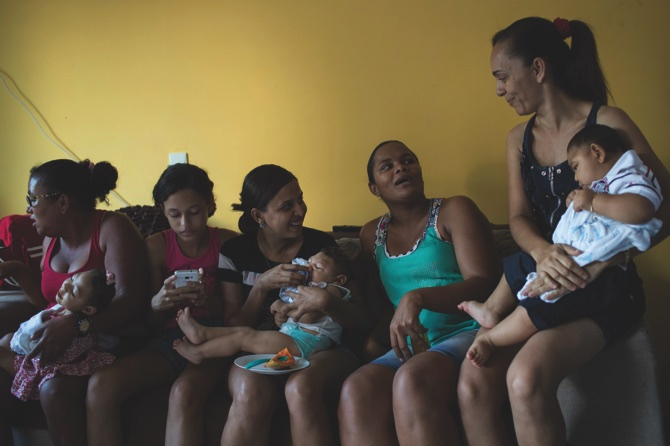 Mothers and friends hold their babies, born with microcephaly, one of many serious medical problems that be caused by congenital Zika syndrome