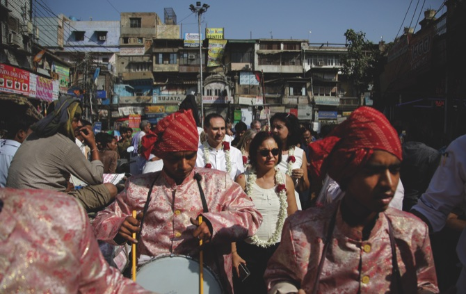 Local band party members play drums as a delegation of Chefs of several heads of states visit Khari Baoli, Asia's largest spice market, in New Delhi