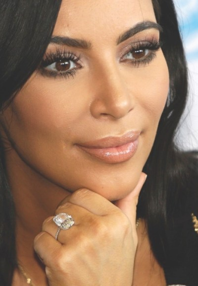FILE - In this June 24, 2015 file photo, American TV personality Kim Kardashian attends the Cannes Lions 2015, International Advertising Festival in Cannes, southern France. Armed robbers forced their way into a private Paris residence where Kardashian West was staying, and stole more than $10 million worth of jewelry, police officials said Monday, Oct. 3, 2016. They said five assailants, who are still at large, stole a jewelry box containing valuables worth 6 million euros ($6.7 million) as well as a ring worth 4 million euros ($4.5 million). (AP Photo/Lionel Cironneau, File)