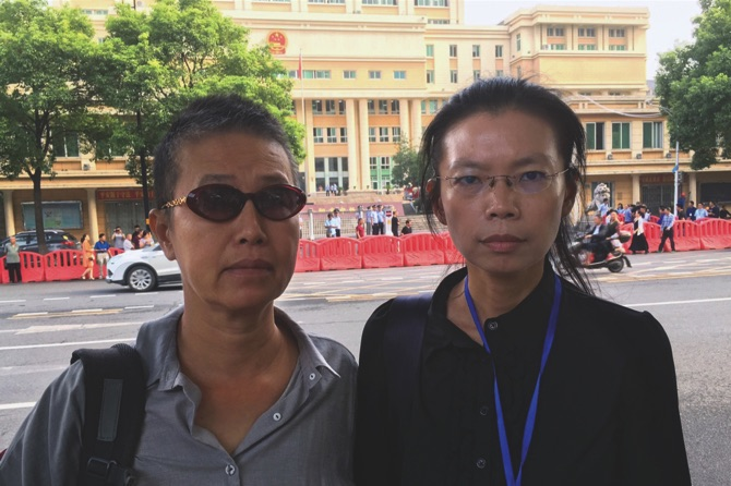Detained Taiwanese activist's wife arrives in China for his trial
