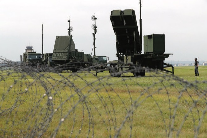Japan approves deployment of new land-based missile shield