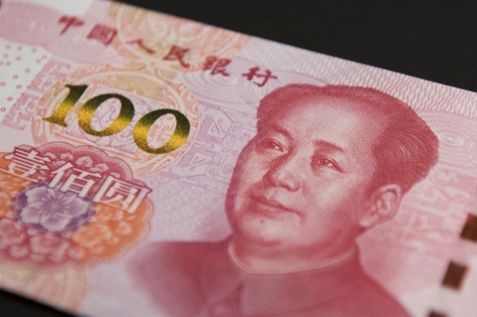 China's central bank sees net forex sales in December