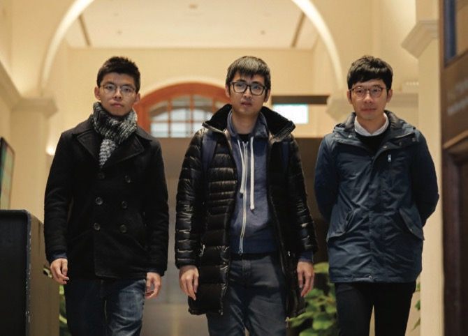 Pro-democracy activists Joshua Wong Alex Chow and Nathan Law walk out of the Court of Final Appeal in Hong Kong yesterday