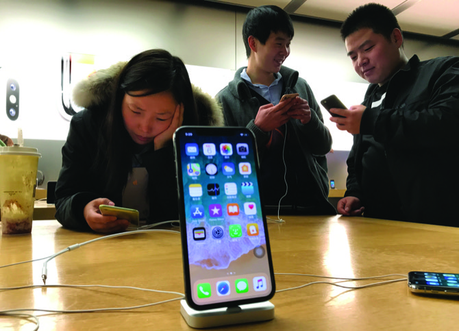 Apple warns China iPhone ban will force settlement with Qualcomm