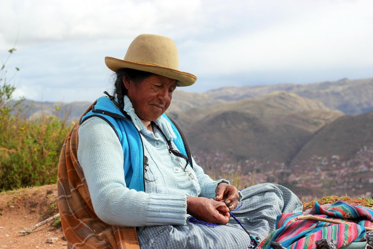A Peruvian woman weaving on the outskirts of Cusco