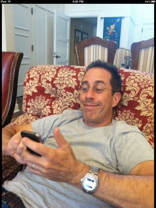 Jerry Seinfeld with his Apple iPhone 4