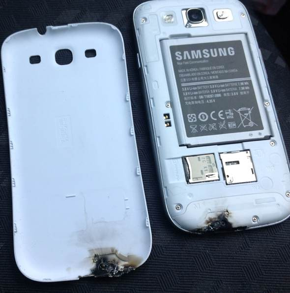 Samsung Galaxy III explodes, burns, flame, sparks